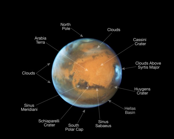 View larger. | Same image as above, with some prominent features on the surface of the planet annotated.