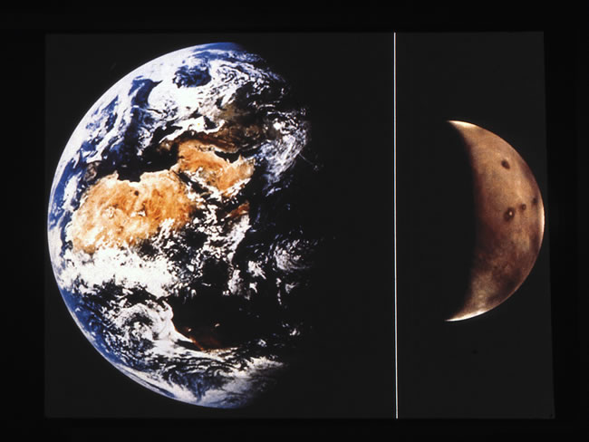 Double photo with large Earth on left and smaller Mars on right, to scale.