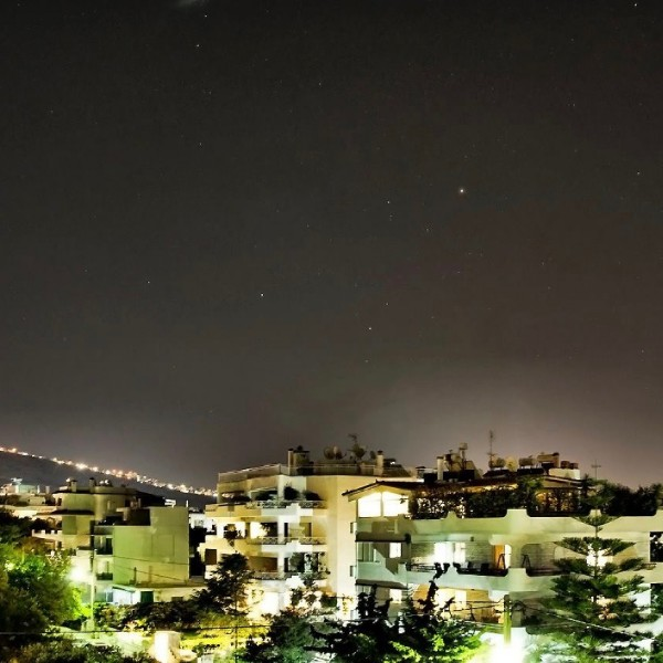 Nikolaus Pantazis in Greece caught Mars, Saturn and the star Antares above the city of Athens on May 28, 2016.