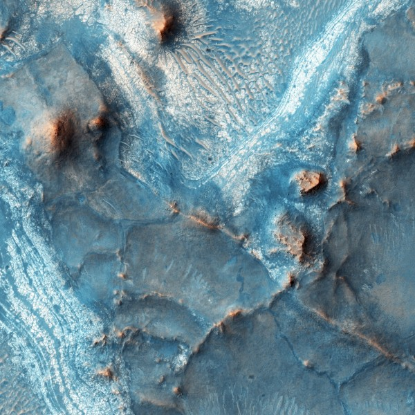 View larger. | This is one of the most colorful places on Mars, as seen by NASA's Mars Reconnaissance Orbiter on February 5, 2016.  It's the The Nili Fossae region, located on the northwest rim of Isidis impact basin. Image via NASA/JPL-Caltech/Univ. of Arizona.