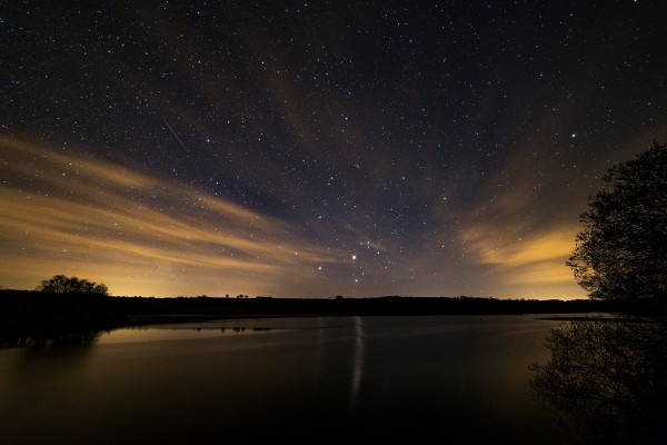 The little triangle of objects just above the horizon is Mars, Saturn and Antares. Notice bright Mars is casting a long reflection in the lake, which is Lake Wimbleball in Somerset, UK. Photo posted to EarthSky Facebook by Paul Howell on May 1, 2016.