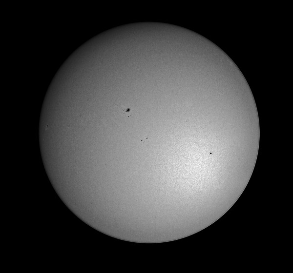 View larger. | Mercury Transit in deep infrared (830 nm) with solar surface stacked and deconvoluted, by Eliot Herman in Tucson, Arizona. Eliot wrote,