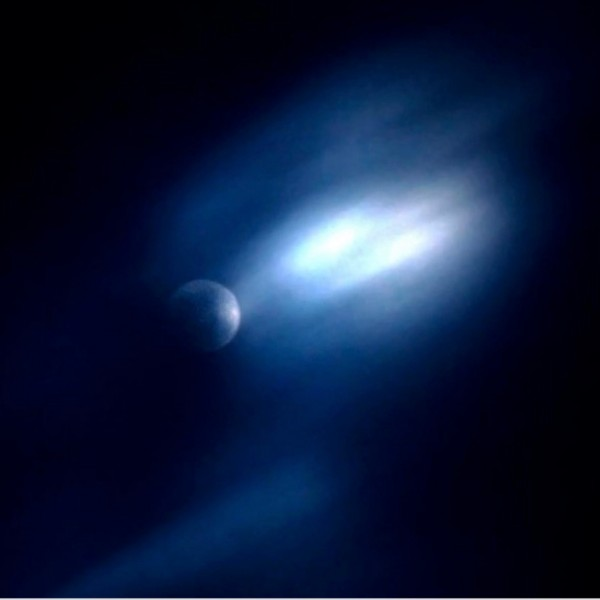 Crescent moon colored blue with blurred blue streaks of clouds.