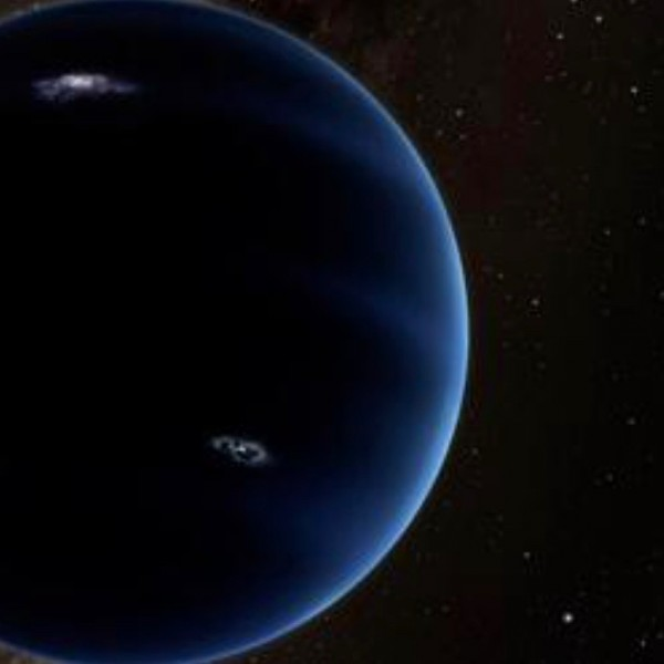 Artist's conception of Planet Nine, in the far outer solar system. In this image, the star in the lower right is our sun. Image via Caltech/R. Hurt (IPAC)