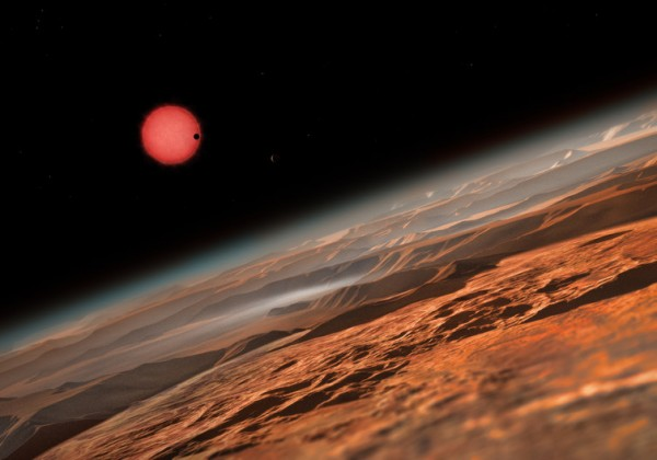 An imagined view from close to one of the three planets orbiting TRAPPIST-1. These worlds have sizes and temperatures similar to those of Venus and Earth – but that's not all it takes to support life. Image credit: ESO/M. Kornmesser