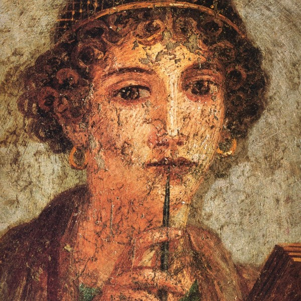 Detail from a portrait of a young woman - A fresco from Pompeii - thought to be Sappho via Museo Archeologico Nazionale (Naples) via Wikimedia Commons.