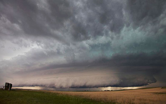 A large wall cloud arcs around a rotating thunderstorm updraft. This storm was documented by the VORTEX2 field campaign on June 6, 2010 near Ogallala, Nebraska. Image via Roger Wakimoto/NSF