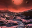 Imagined view from the surface of one of the newly discovered planets, with ultracool dwarf star TRAPPIST-1 in the background. Image credit: ESO/M. Kornmesser