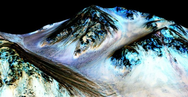 Streaks down Martian mountains are evidence of liquid water running downhill – and hint at the possibility of life on the planet. Image credit: NASA/JPL/University of Arizona