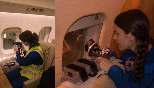 Janna Feeley from the Aerospace Corporation (Left) and Eleanor Sansom from Curtin University (right), setting up aboard the aircraft to observe the Cygnus re-entry. Image via Cygnus Shallow Re-entry Observing Campaign.