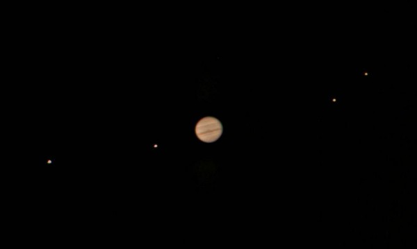 View larger. Jupiter and the Galilean moons through a 10