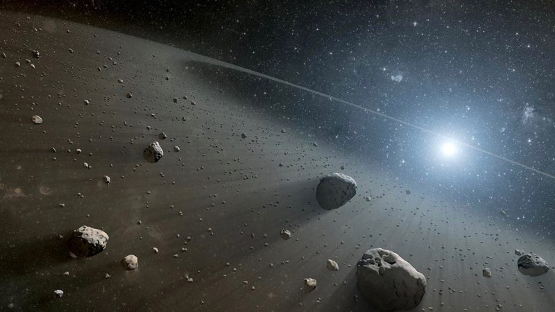 Space scene with many floating rocks illuminated with sunlight.