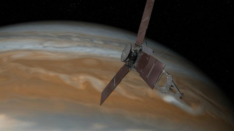 This artist's rendering shows NASA's Juno spacecraft making one of its close passes over Jupiter. Image via  NASA/JPL-Caltech