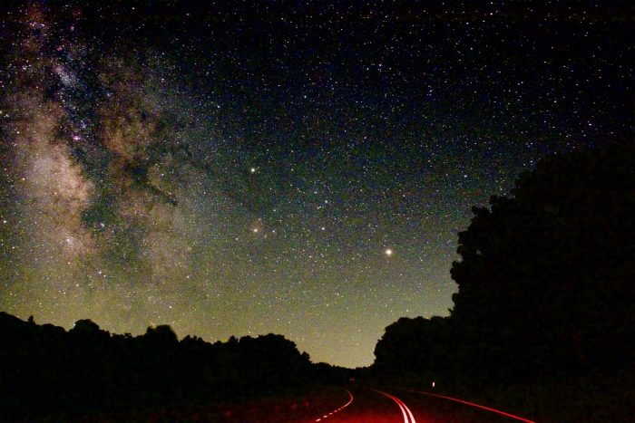 Earth passed between Mars and the sun in May, and Mars is bright in our sky now. This June 13, 2016 photo shows the planet above Skyline Drive in Shenandoah National Park in Virginia. Mars is the bright one just above the road. Greg Redfern captured this shot.  Visit EarthSky's planet guide.