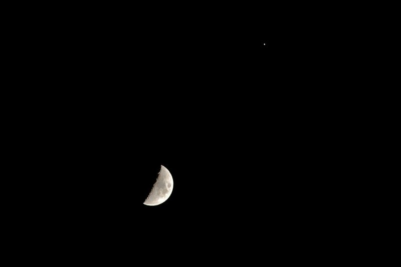 EarthSky Facebook friend Nikolaos Pantazis in Athens, Greece caught the nearly first quarter moon on June 11, 2016.  The bright object near the moon is Jupiter.