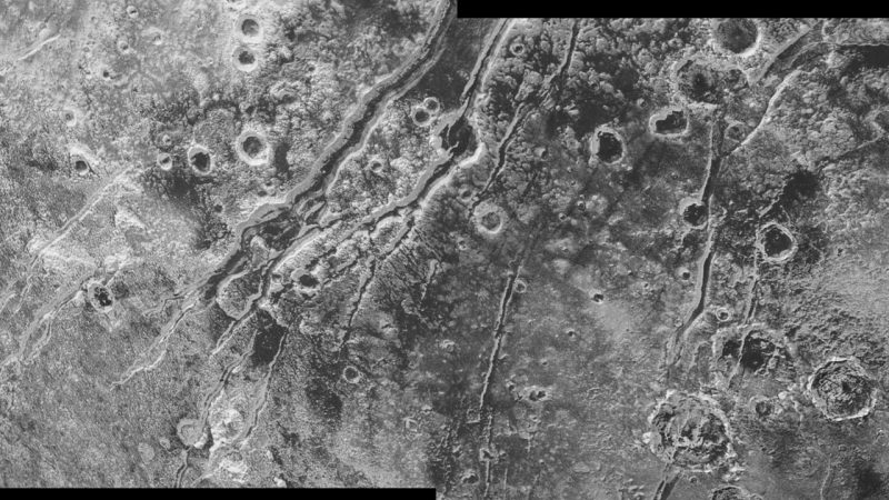 NASA's New Horizons spacecraft spied extensional faults on Pluto, a sign that the dwarf planet has undergone a global expansion possibly due to the slow freezing of a sub-surface ocean. A new analysis by Brown University scientists bolsters that idea, and suggests that ocean is likely still there today. Image credit: NASA/JHUAPL/SwRI.