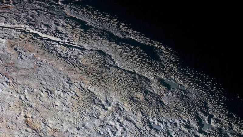 This 300-mile (500-km) swath of land on Pluto shows what scientists are calling snakeskin topography, possibly a combination of internal tectonic forces and ice sublimation driven by Pluto's faint sunlight.  Image via geology.com.