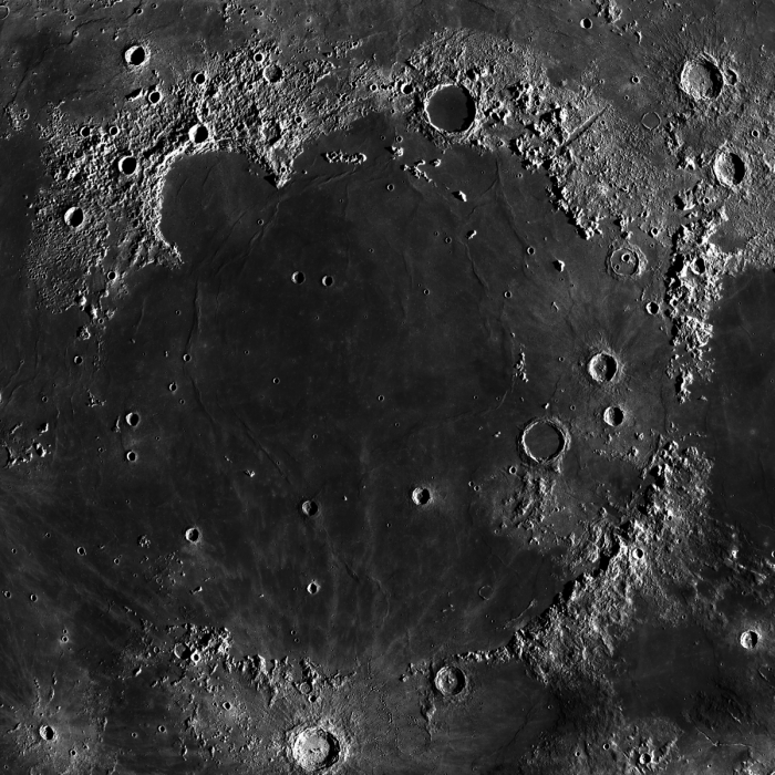 Mare Imbrium on the Moon. Mosaic of photos by Lunar Reconnaissance Orbiter, made with Wide Angle Camera. Size of the image is 1100×1100 km, north is up. A map in orthographic projection, centered at 34.7°N, 14.9°W (but center of the cropped piece is somewhat other). Via Wikimedia Commons.