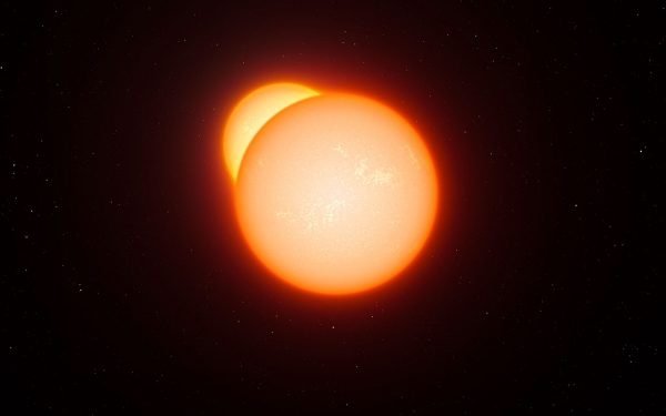 Large glowing orange sun with part of smaller yellow sun visible behind it.