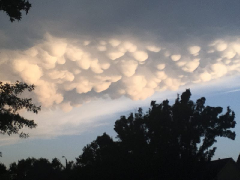 Clouds with multiple glowing white rounded downward bulges.