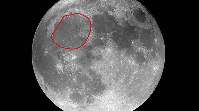 Large, roundish dark area circled on a photo of the moon.