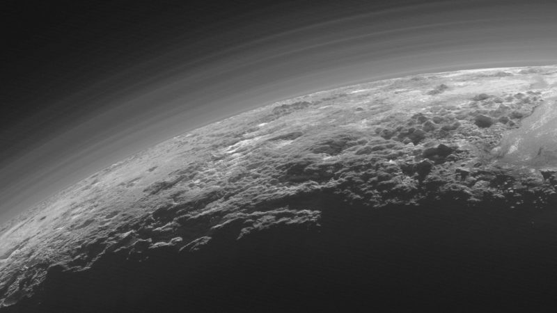 Just 15 minutes after its closest approach to Pluto on July 14, 2015, NASA's New Horizons spacecraft looked back toward the sun and captured this near-sunset view of the rugged, icy mountains. Image credit: NASA/JHUAPL/SwRI
