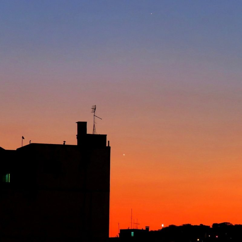 Venus is brighter, to the right of the building. Mercury is at the top of the frame. Photo taken July 23, 2016 by Helio C. Vital in Rio de Janeiro, Brazil.