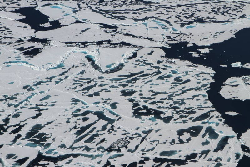 Arctic sea ice has varied terrain in the summer months, as ridges and melt ponds form and floes break apart. A new NASA satellite called ICESat-2, launching in 2018, will measure the height of sea ice year-round. Image via NASA/Kate Ramsayer