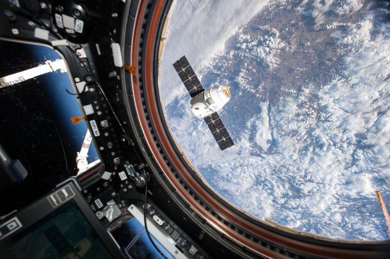 NASA astronaut Tim Kopra captured an image of the SpaceX Dragon spacecraft, on the company's eighth Commercial Resupply Services mission, from the Cupola Module of the International Space Station during Expedition 47 in April 2016. Image via NASA