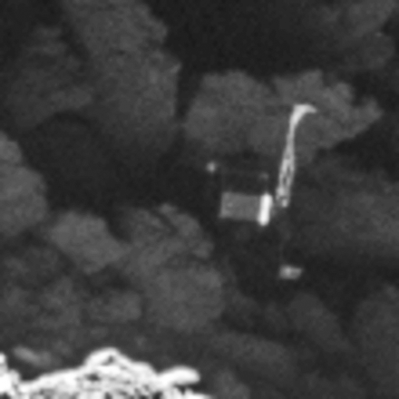 Close-up of the Philae lander, imaged by Rosetta's OSIRIS narrow-angle camera on 2 September 2016 from a distance of 2.7 km. The image scale is about 5 cm/pixel. Philae's 1 m-wide body and two of its three legs can be seen extended from the body. The images also provide proof of Philae's orientation. Image via ESA.