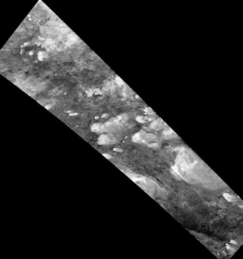 Hundreds of sand dunes are visible as dark lines snaking across the surface. Image Credit: NASA/JPL-Caltech/ASI/Université Paris-Diderot