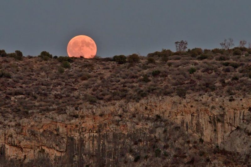 Nikolaos Pantazis got this shot of the Harvest Moon, rising over Vouliagmeni Lake, Greece.