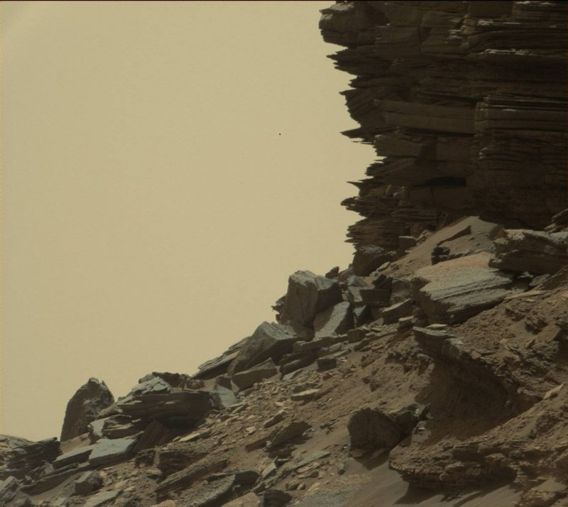 his view from Curiosity shows a dramatic hillside outcrop with sandstone layers that scientists refer to as