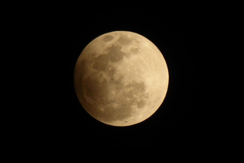 Peter Lowenstein in Mutare, Zimbabwe also caught the September 16 moon in penumbral eclipse.  For Peter in the Southern Hemisphere, this full moon was the nearest full moon to the spring equinox.