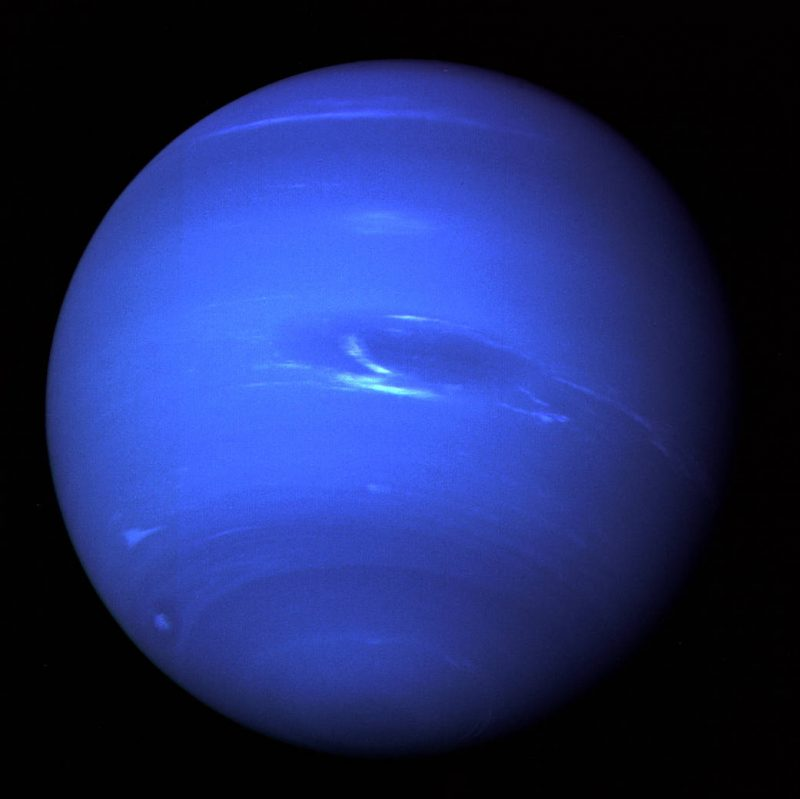 Another Voyager 2 image of Neptune, acquired on August 20, 1989, at a range of 4.4 million miles from the planet, 4 days and 20 hours before closest approach on August 25. The picture shows the Great Dark Spot and its companion bright smudge; on the west limb the fast moving bright feature called