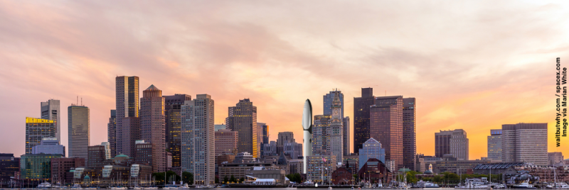 Artist's concept of SpaceX's rocket, upright in the city of Boston. It's as big as a skyscraper, by far the biggest rocket ever built. Image via Wait But Why.