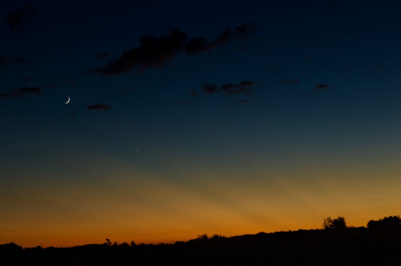 September 3 sunset with crepuscular rays, the young moon and Venus from Ernie Braganza in Abingdon, Virginia.