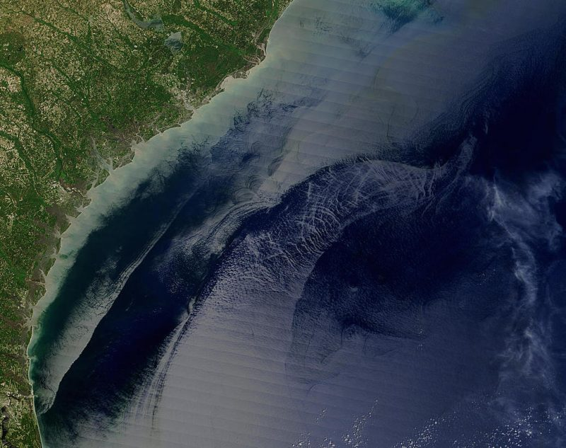 This image, obtained  by the Moderate Resolution Imaging Spectroradiometer (MODIS) on NASA's Terra satellite on April 18, 2004, shows the Georgia and Carolinas shoreline. The Gulf Stream is the water feature with a rough sea surface that appears to curve away from the coast.  Image via Jacques Descloitres, MODIS Rapid Response Team, NASA/GSFC http://visibleearth.nasa.gov/view.php?id=71157
