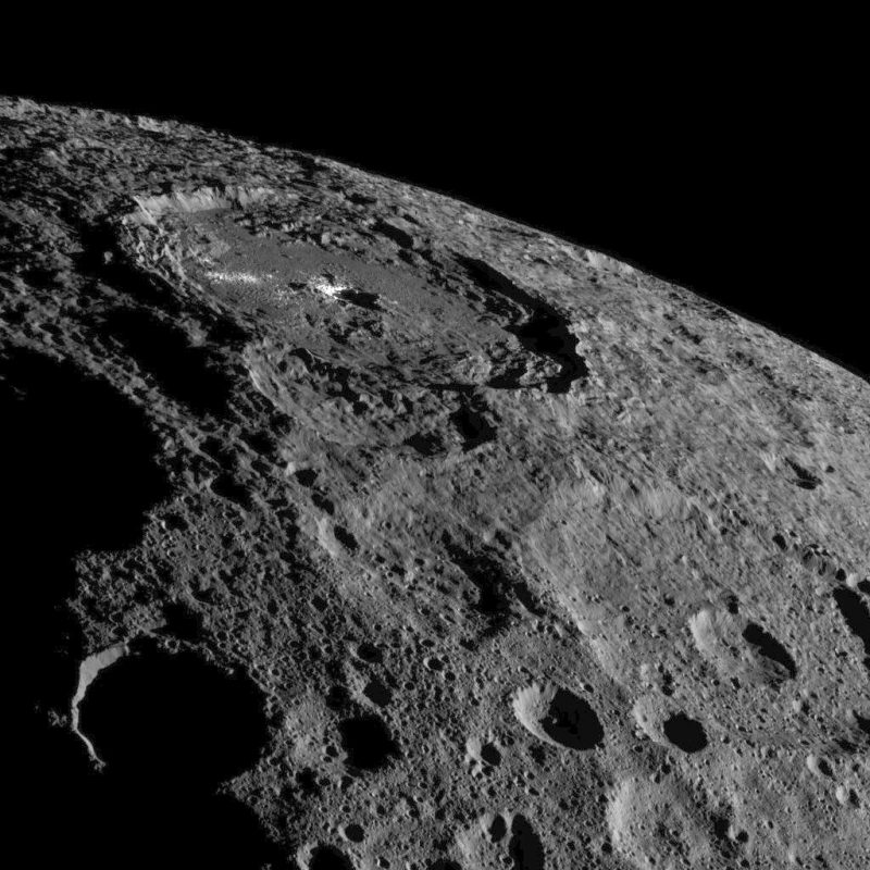 Occator Crater, some 57 miles across and home of Ceres' intriguing brightest areas, is prominently featured in this image from NASA's Dawn spacecraft. Click the picture for a full-size version. Image credit: NASA/JPL-Caltech/UCLA/MPS/DLR/IDA.