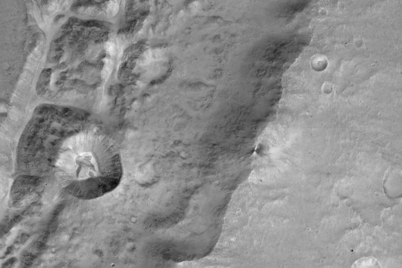 A mile-wide (1.4 km) crater on the rim of a larger crater near Mars' equator, as seen from CaSSIS. Image via University of Bern.