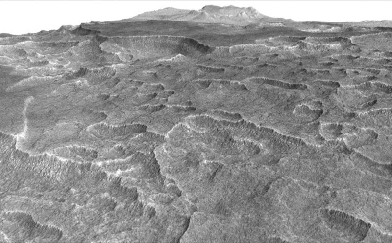 This vertically exaggerated view shows scalloped depressions in a part of Mars where such textures prompted researchers to check for buried ice, using ground-penetrating radar aboard NASA's Mars Reconnaissance Orbiter. Image via NASA/JPL-Caltech/Univ. of Arizona