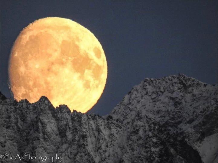 Rising moon on November 11, 2016 by Kathy Ax.