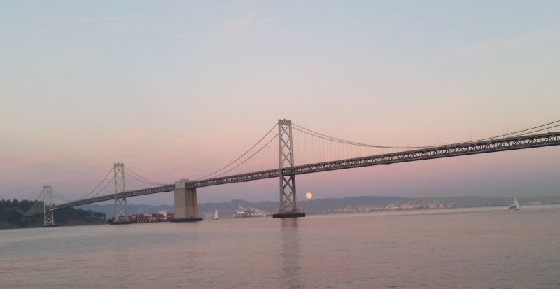 Sunday evening's rising supermoon over the San Francisco Bay Bridge by Fran Heller.