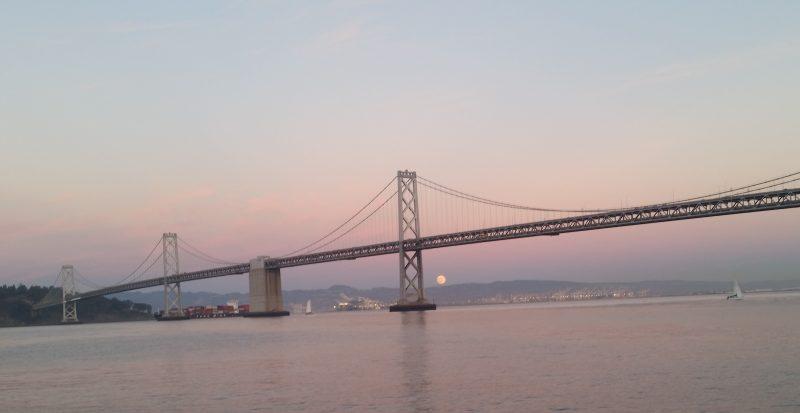 Sunday evening's rising supermoon over the San Francisco Bay Bridge by Fran Heller.