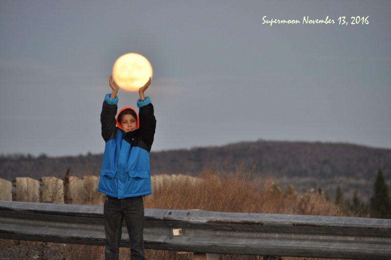 Supermoon and friend Sunday evening, by Roxana Soetebeer in Woodstock, New Brunswick, Canada.