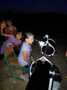 Students in the Ukraine look through a telescope.