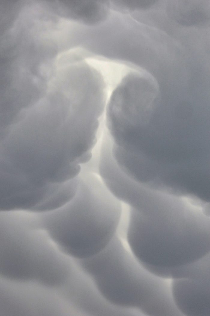 Swirling mammatus clouds under the departing anvil cloud.