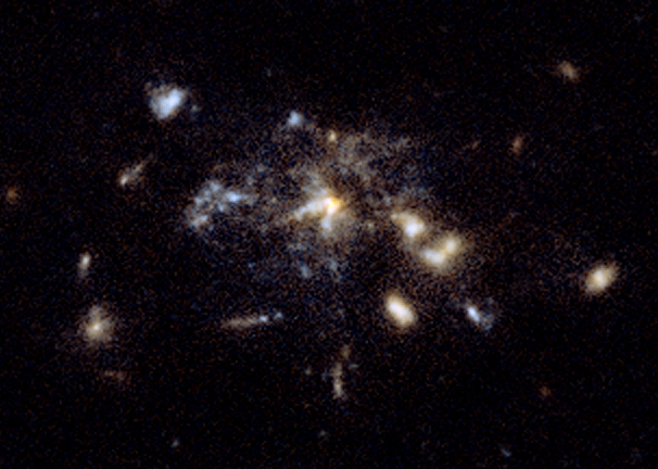 An earlier view of the Spiderweb galaxy - aka MRC1138-262 - from the Hubble Space Telescope in 2006. The newer observations give us a much-better look at the gas from which this giant galaxy is forming. Image via Wikimedia Commons.