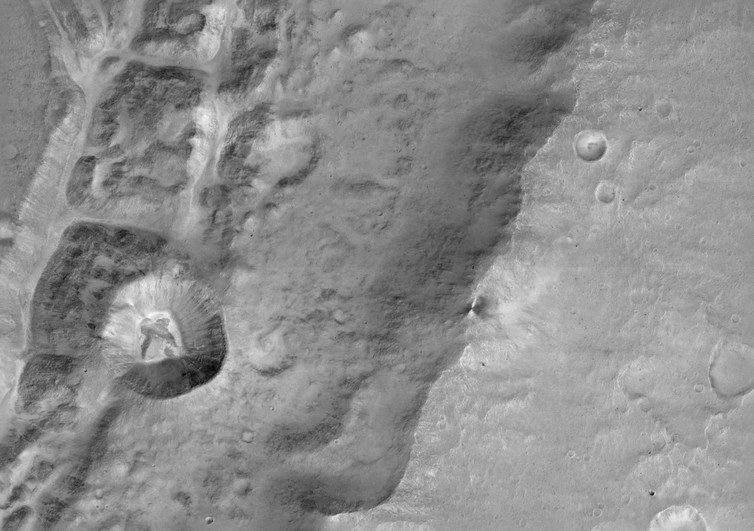 ExoMars close-up of a large unnamed crater north near the Mars equator. Image via ESA/Roscosmos/ExoMars/CaSSIS/UniBE