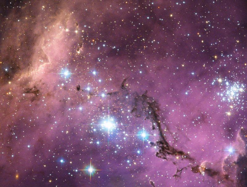 Nearly 200 000 light-years from Earth, the Large Magellanic Cloud, a satellite galaxy of the Milky Way, floats in space, in a long and slow dance around our galaxy. As the Milky Way's gravity gently tugs on its neighbour's gas clouds, they collapse to form new stars. In turn, these light up the gas clouds in a kaleidoscope of colors, visible in this image from the NASA/ESA Hubble Space Telescope. Image via ESA/NASA/Hubble